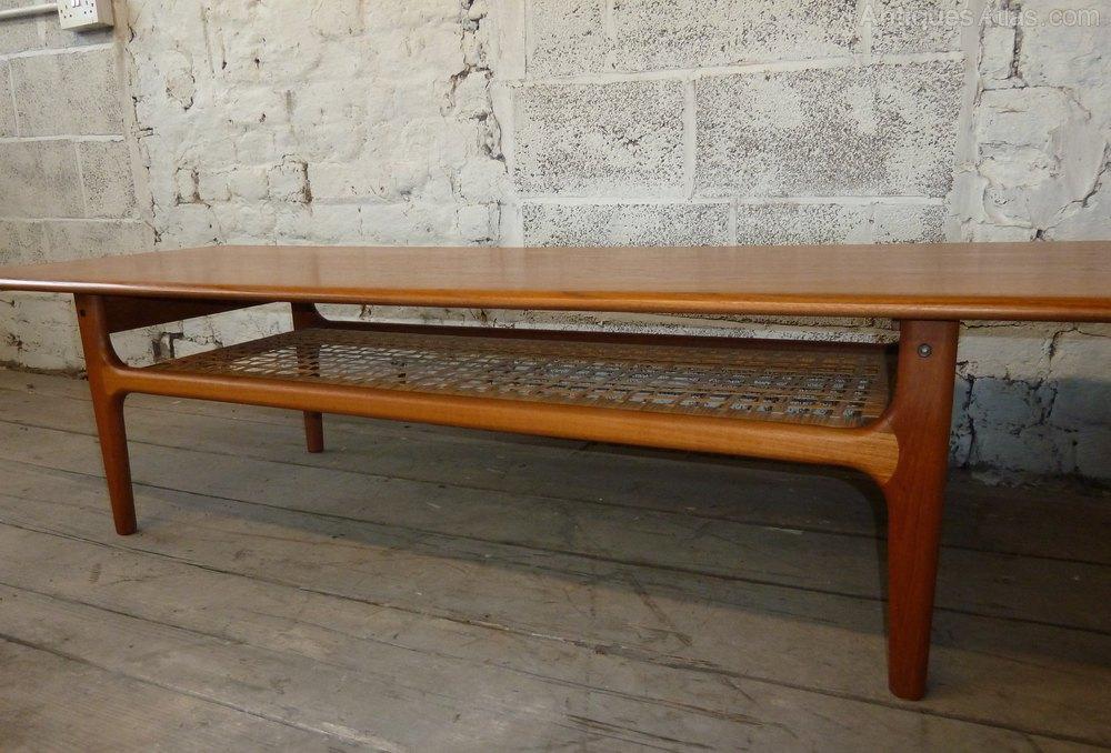 antiques atlas - danish teak coffee table with cane magazine rack