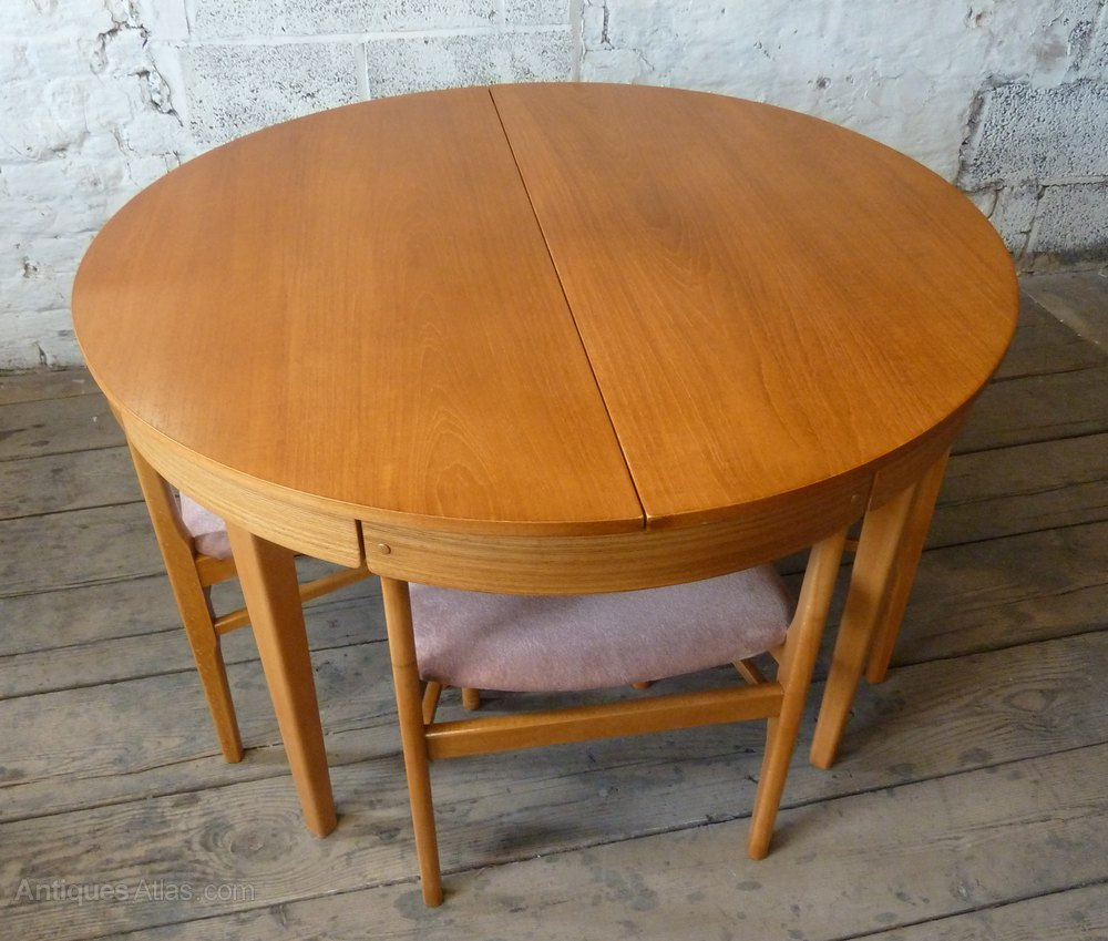 Antiques atlas round extending teak dining table 4 chairs for Round dining table set for 4
