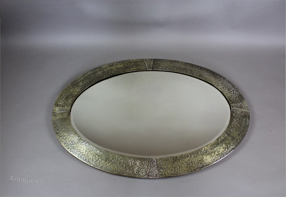 Antiques atlas arts and crafts oval wall mirror for Mirror 60cm wide
