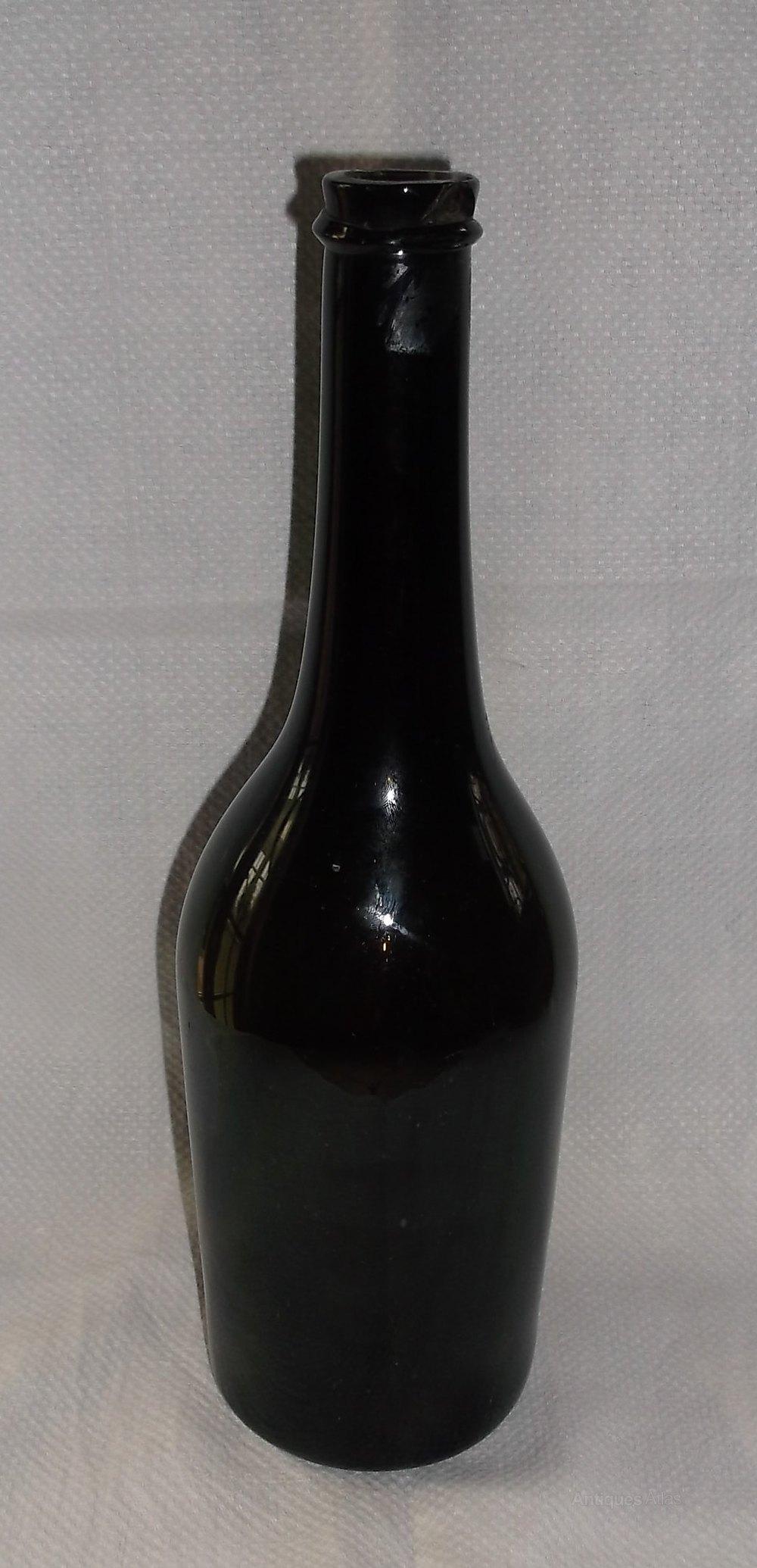 Antiques atlas 19th century green glass wine bottle for Glass bottles for wine