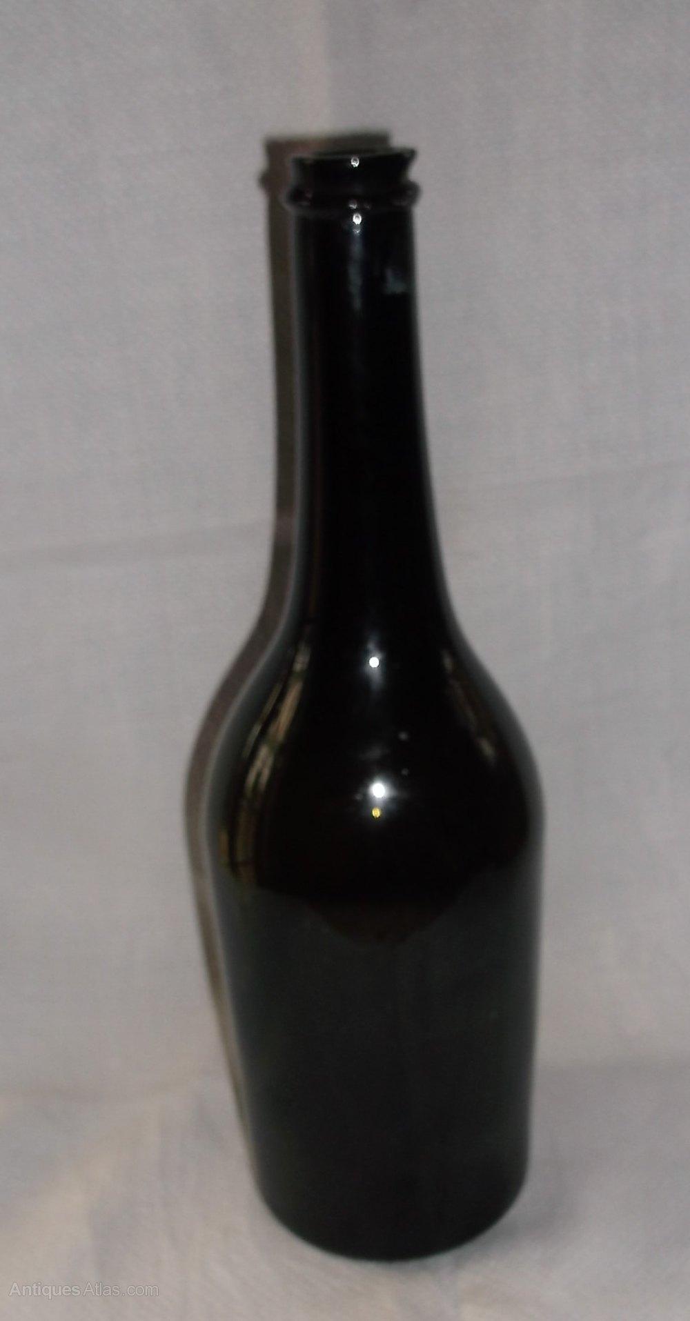 Antiques atlas 19th century green glass wine bottle for Green glass wine bottles