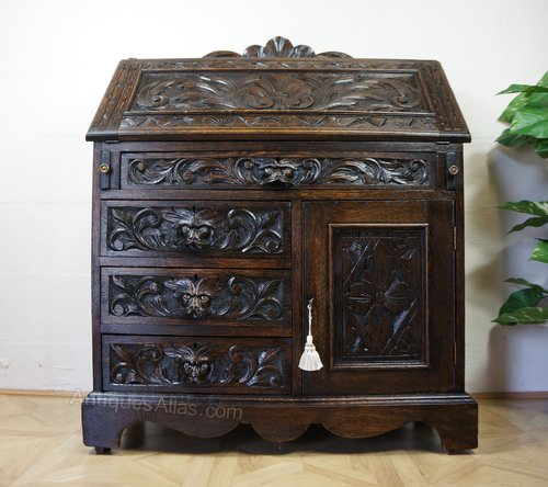 profusely carved green man bureau chest of drawers antiques atlas. Black Bedroom Furniture Sets. Home Design Ideas