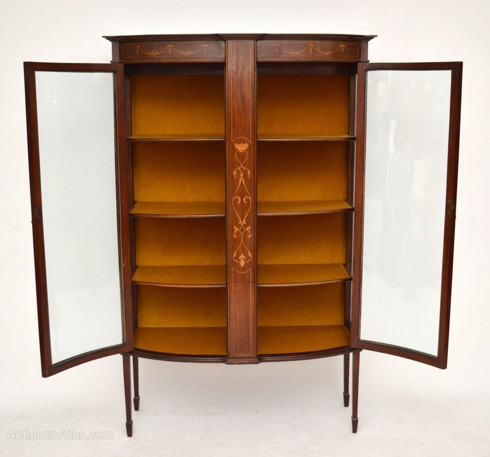 Antique inlaid mahogany bow front display cabinet for Antique display cabinet
