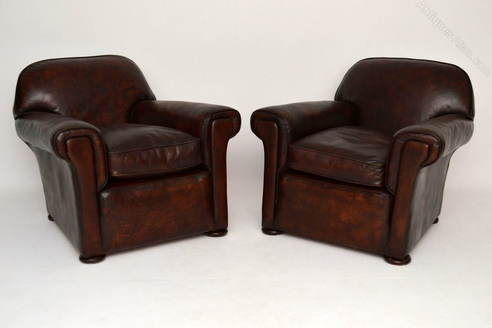 Large pair antique english leather club armchairs