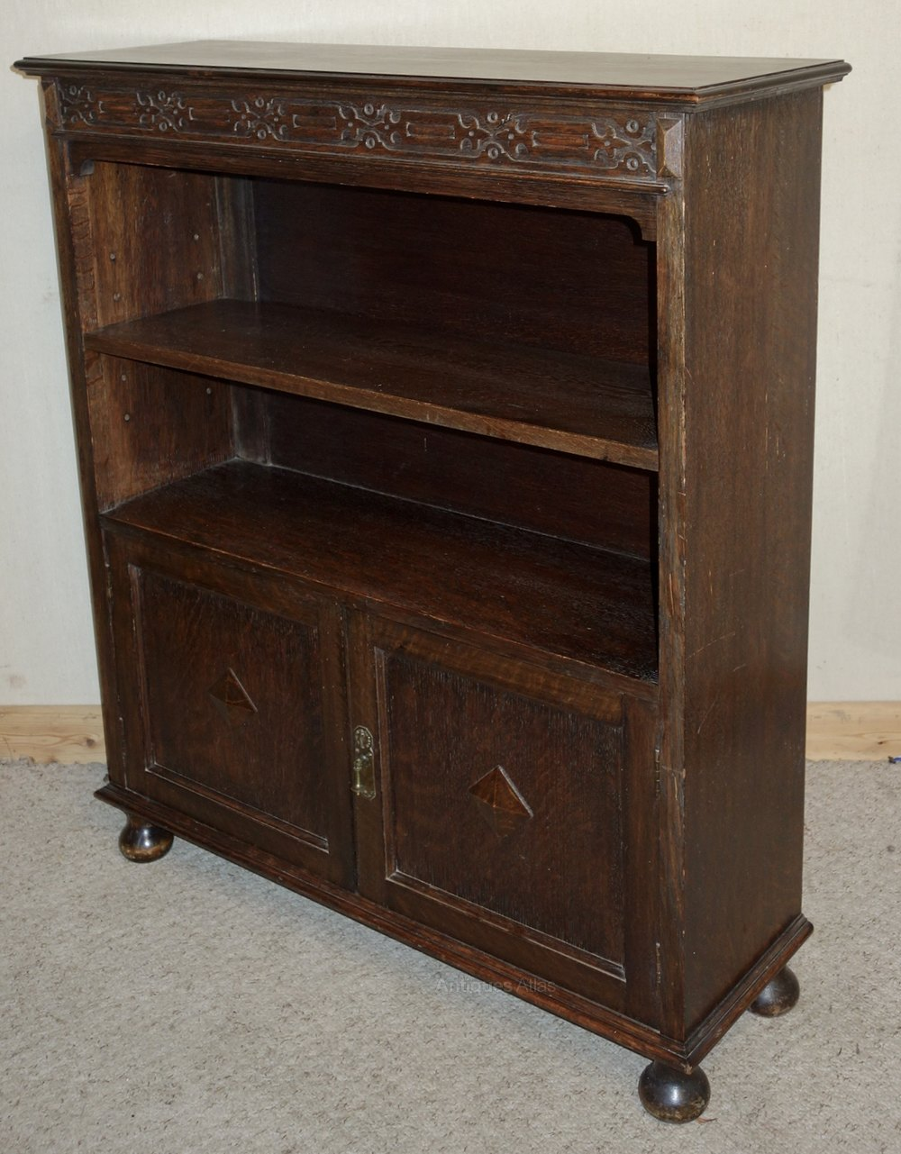 Carved oak open bookcase with cupboard antiques atlas