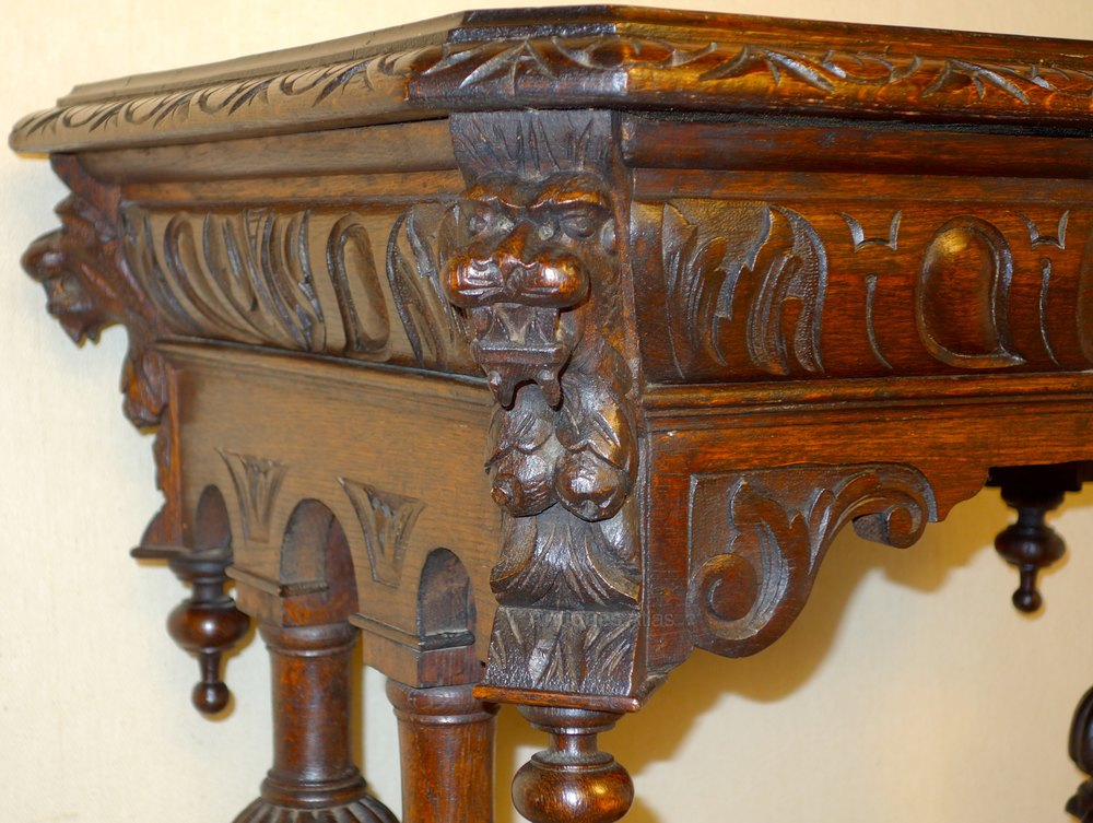 Victorian carved oak dolphin centre table small
