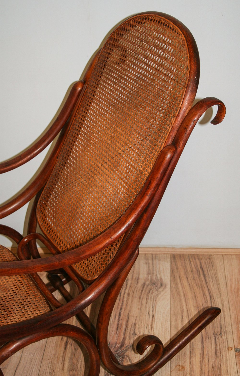 this elegant bentwood rocking chair dates to around 1900 and is