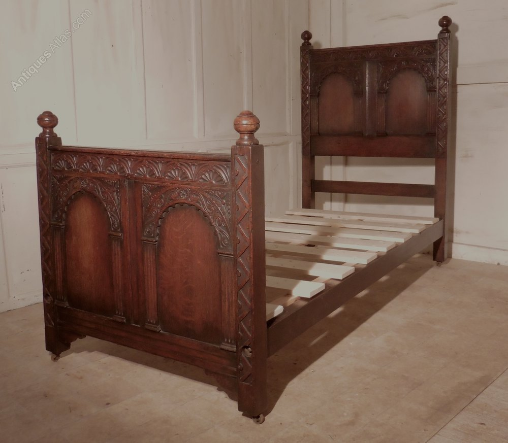 A superb victorian gothic carved oak single bed antiques for Gothic style beds for sale
