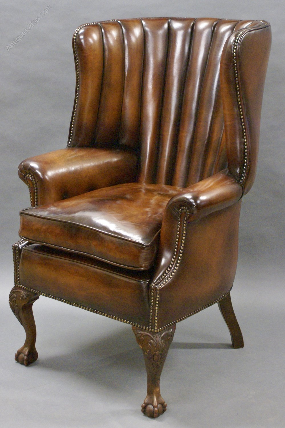 A George Ii Style Leather Upholstered Wing Chair