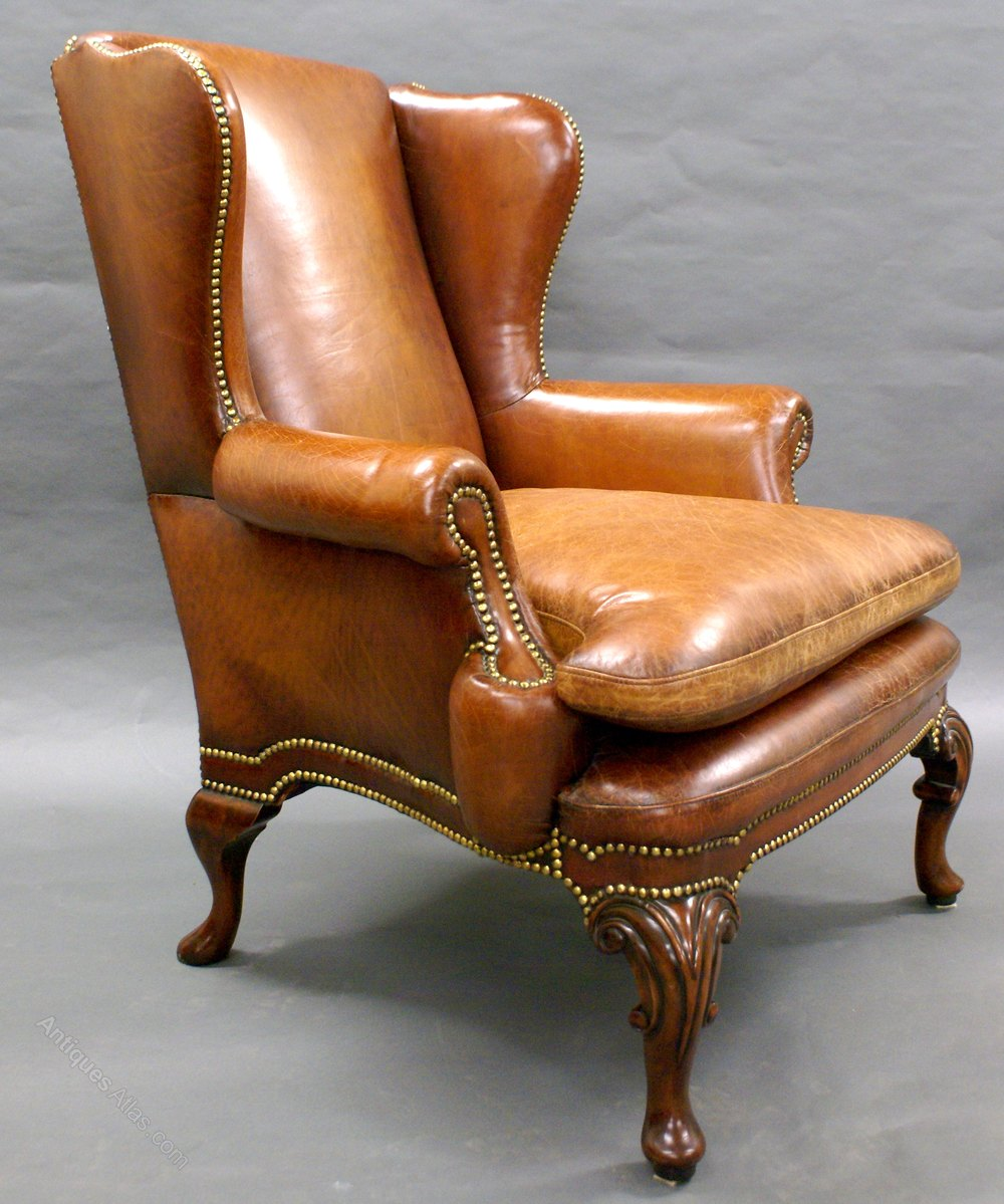 A georgian style leather upholstered wing chair antiques for Antique leather chairs