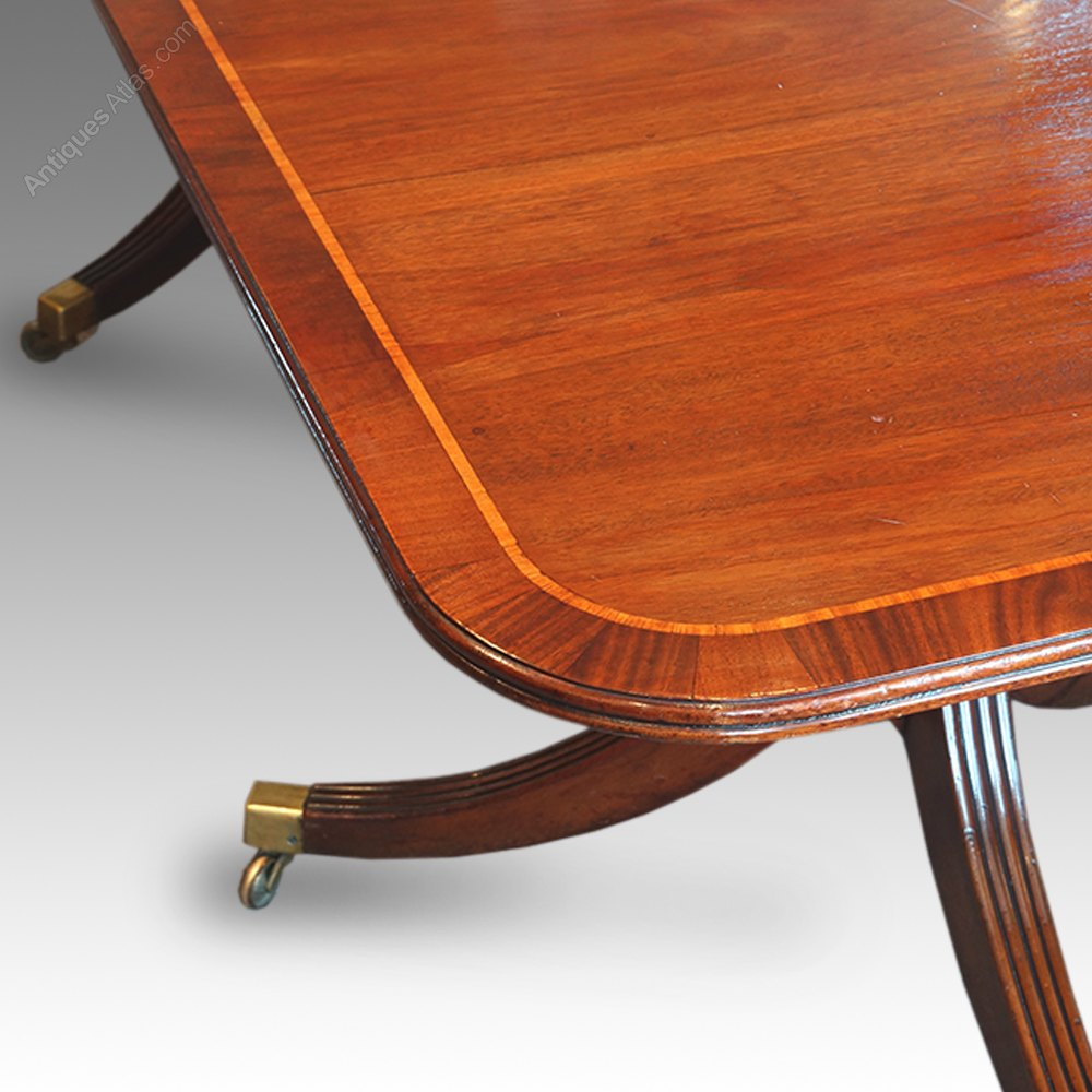 Regency style mahogany cross banded twin pillar dining for Pillar dining table