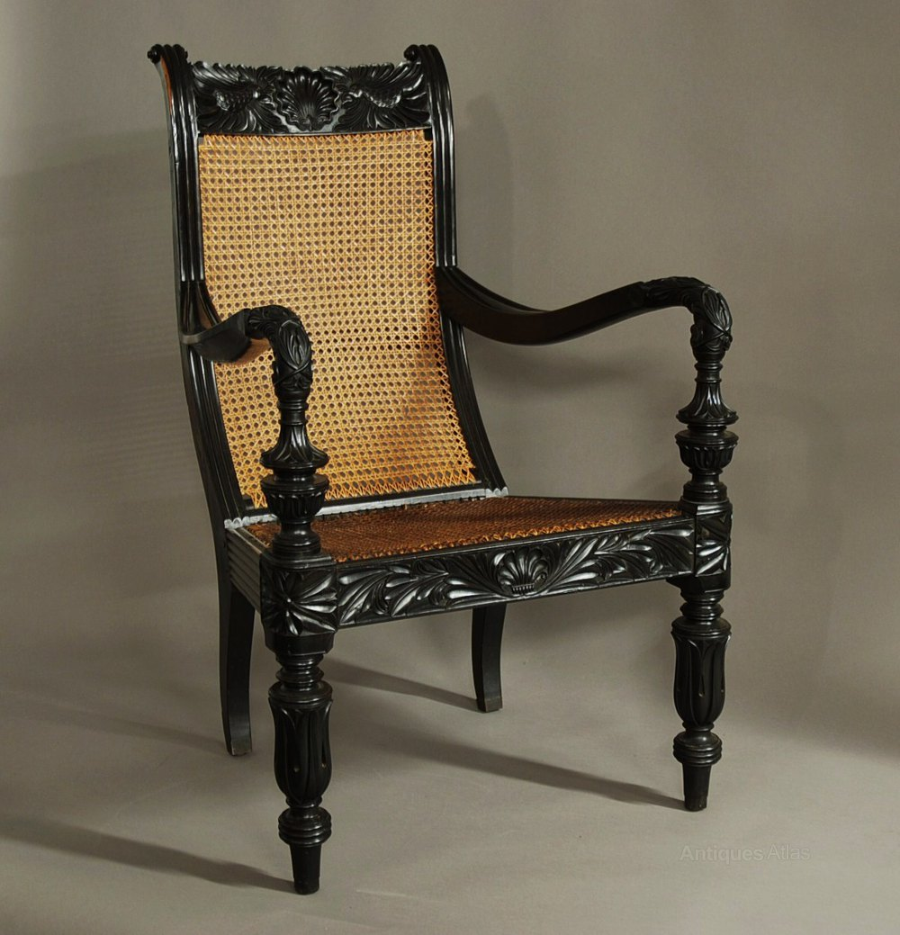A Carved Solid Ebony Chair From The Galle District