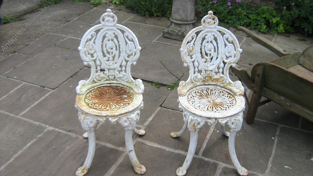 Antiques atlas a pair of victorian cast iron garden chairs for Cast iron garden furniture