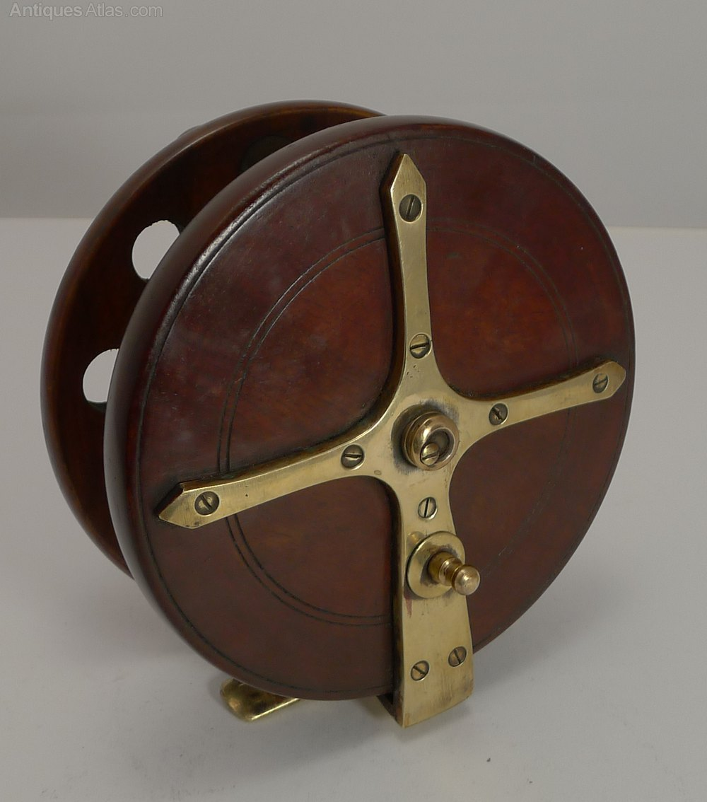 Antiques atlas mahogany and brass star back fishing reel for Antique fishing reels