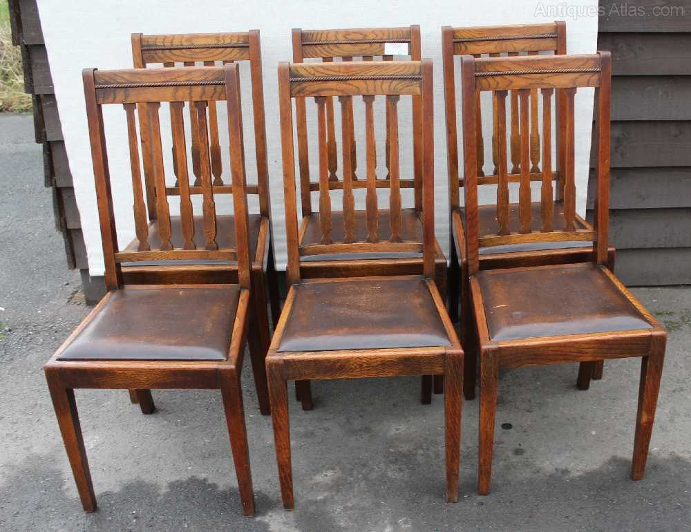 set 6 high back oak dining chairs with pop out brown leather seats in