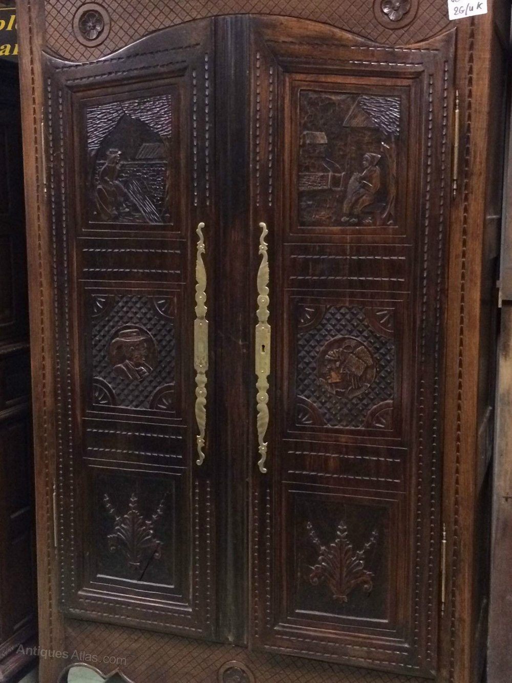 Highly carved breton door armoire oak brass