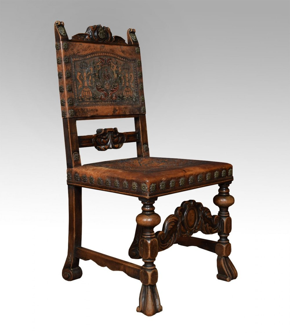 set of fourteen baroque style walnut dining chairs