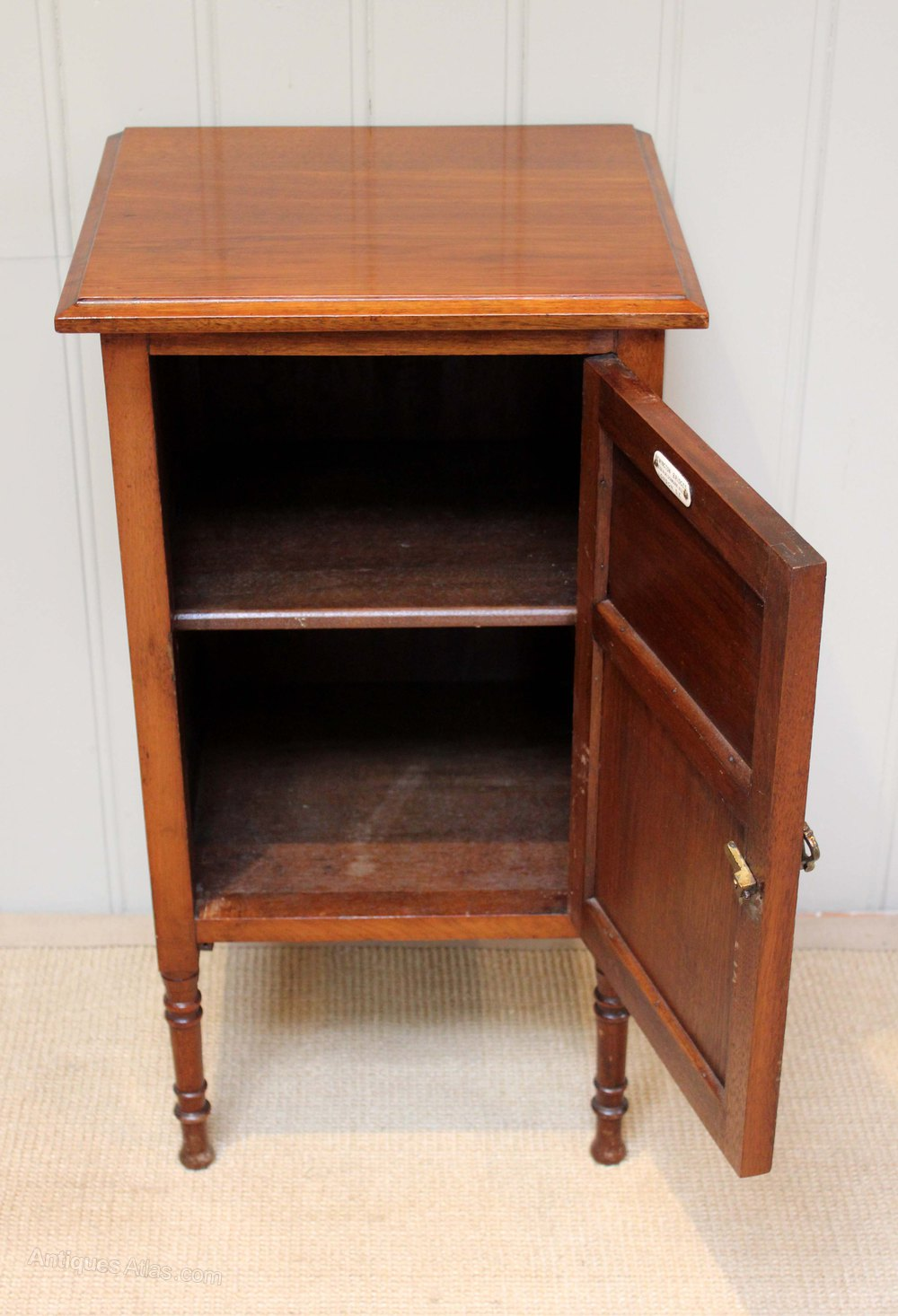 edwardian walnut bedside cabinet having a single panelled door having