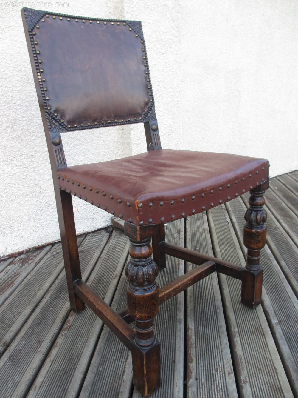 10 carved oak and leather studded dining chairs antiques for Studded dining room chairs