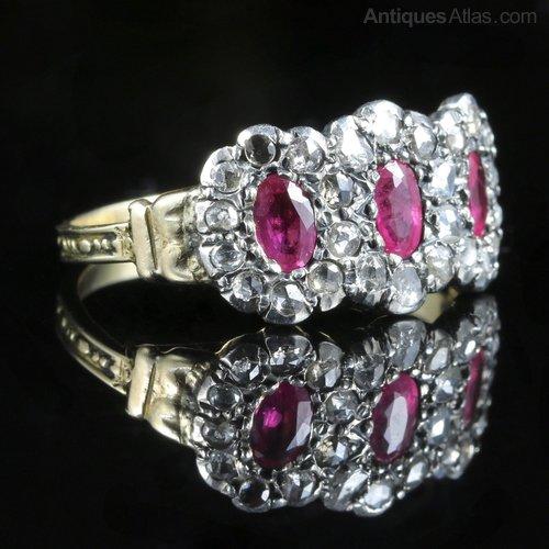 A Georgian era triple cluster diamond ring with rubies