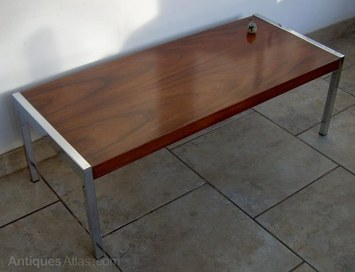 A Rosewood And Chrome Coffee Table