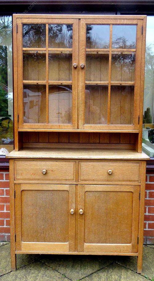 A Glazed Oak Kitchen Dresser By Heal