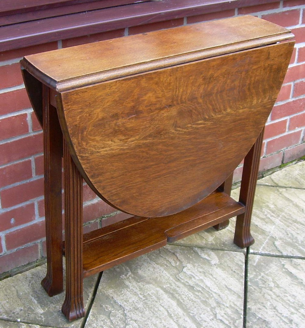 An Art Deco Oak Oval Drop Leaf Or Gate Leg Table ...
