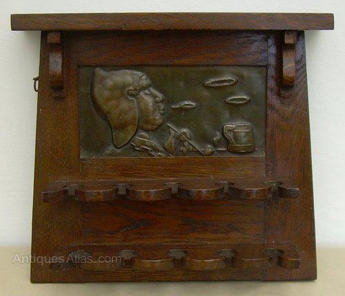 An Arts & Crafts Oak Pipe Rack - Antiques Atlas