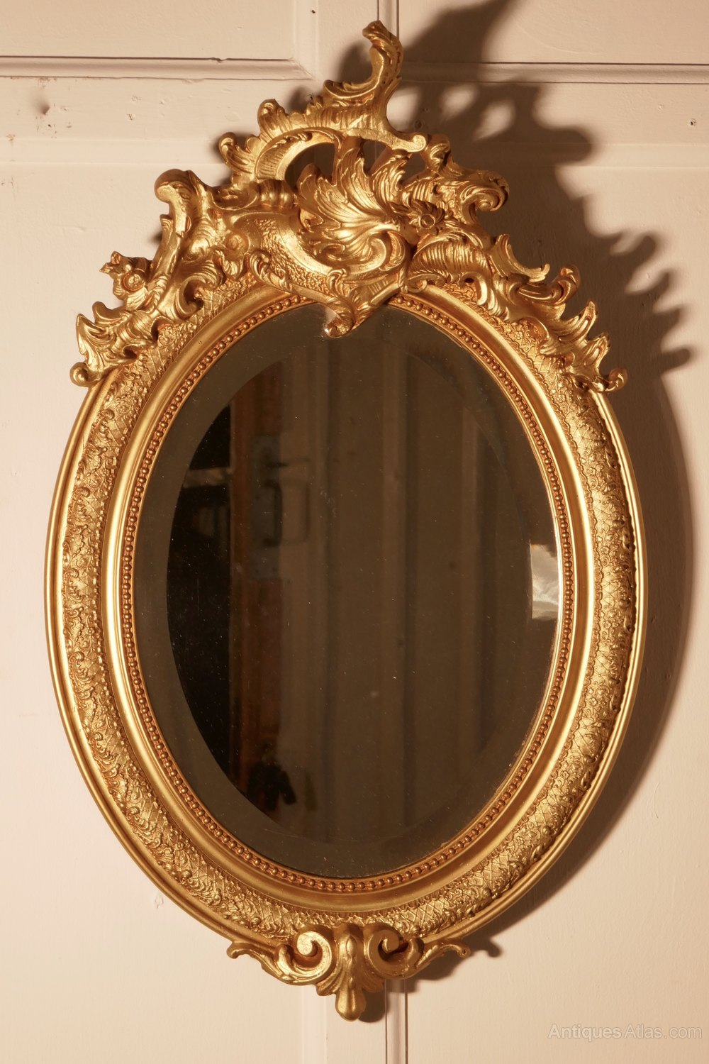Antiques Atlas - A Dainty French Rococo Oval Gilt Wall Mirror