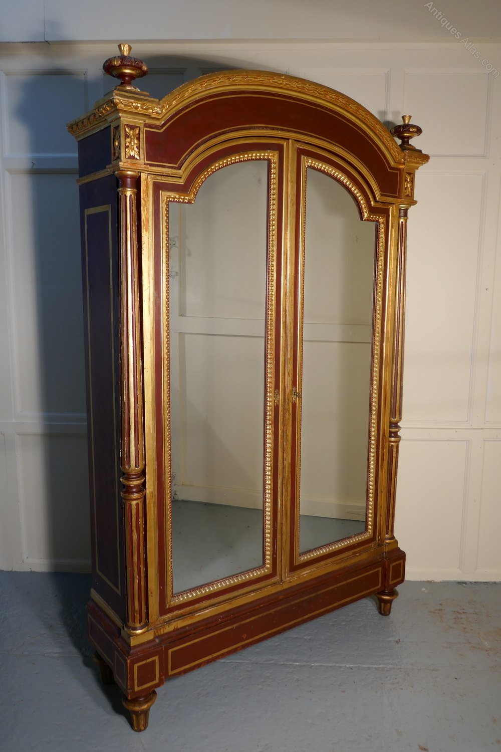 a glamorous french art deco gold burgundy armoire. Black Bedroom Furniture Sets. Home Design Ideas