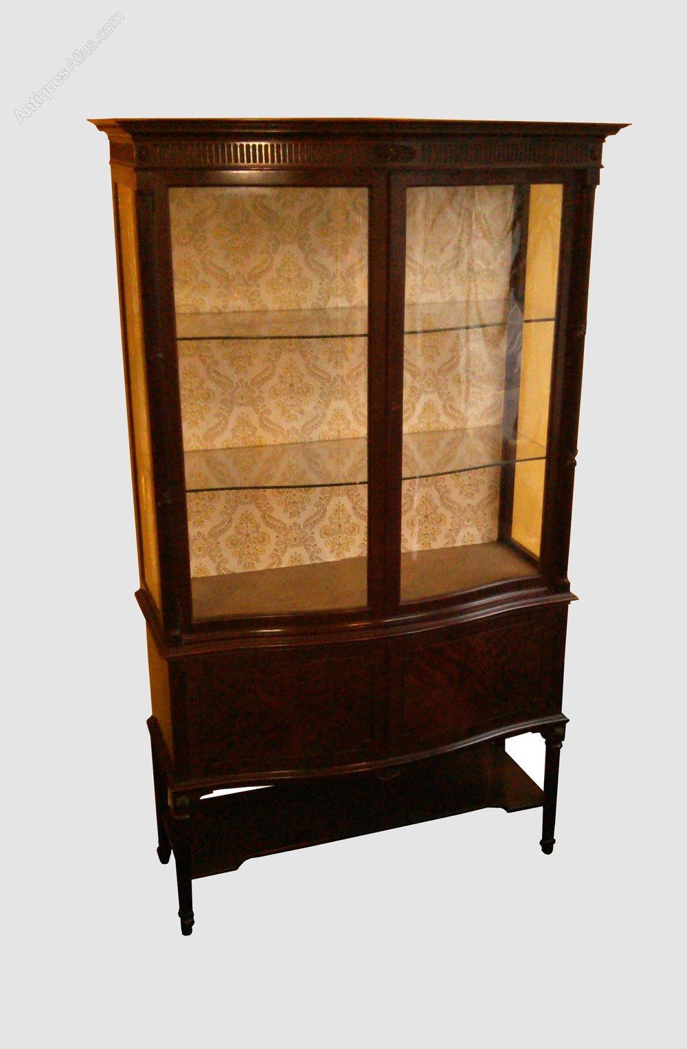 Fine quality serpentine fronted glass display cabinet for Antique display cabinet