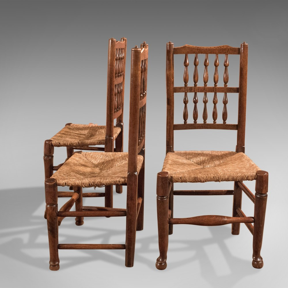 Harlequin Set 7 Antique Spindle Back Dining Chairs