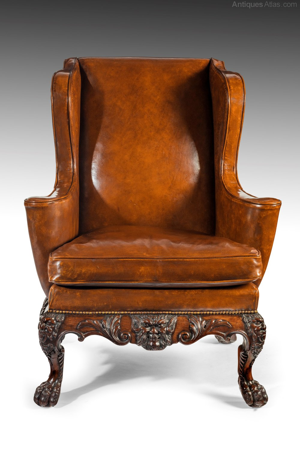 A Handsome Victorian Leather Carved Wing Chair Antiques