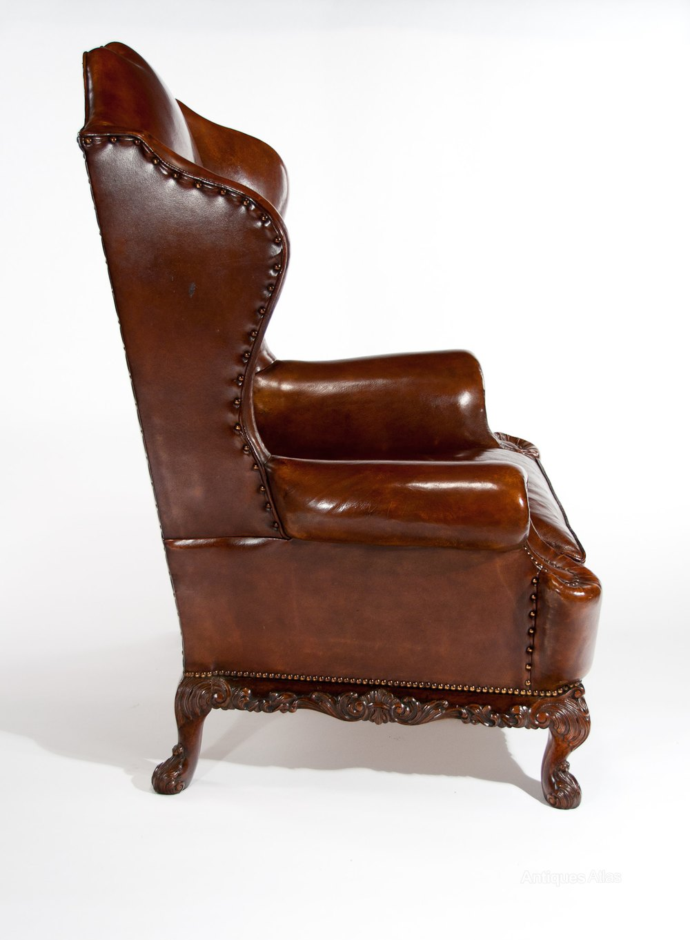 A Quality Walnut Leather Upholstered Wing Chair Antiques
