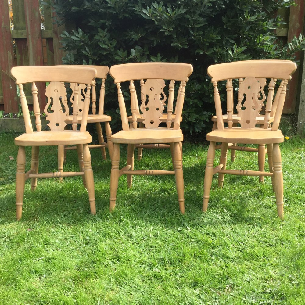 of six solid pine wooden chairs suitable for kitchen or dining room