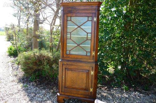Antique oak glazed corner cupboard c1900