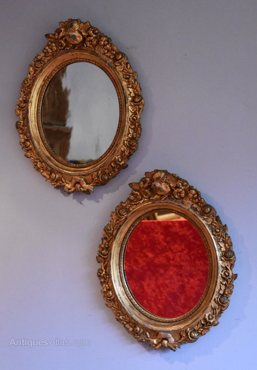 Pair Of Victorian Small Oval Gilt Mirrors