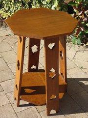 Arts & Crafts Octagonal oak table with pierced leg