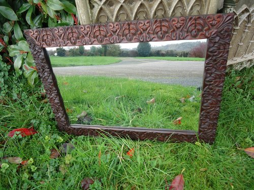 Arts & Crafts carved mirror