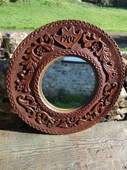 Arts & Crafts circular carved mirror dated 1907
