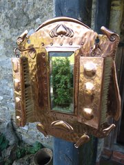 Arts & Crafts copper hall mirror with brushes