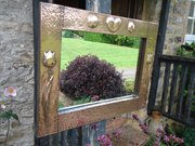 Arts & Crafts copper mirror with tulips to sides