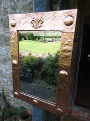 Arts & Crafts copper mirror with Fleur-de-lys
