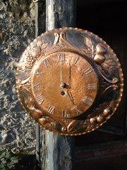 Arts & Crafts copper wall clock