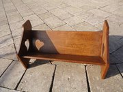 Arts & Crafts oak book trough with pierced hearts