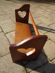Arts & Crafts oak book trough with heart to ends