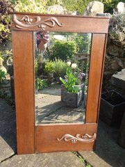 Arts & Crafts oak mirror with floral decoration