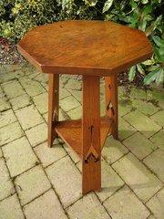 Arts & Crafts oak table on a tripod base.