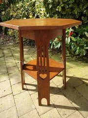 Arts & Crafts oak table with pierced hearts