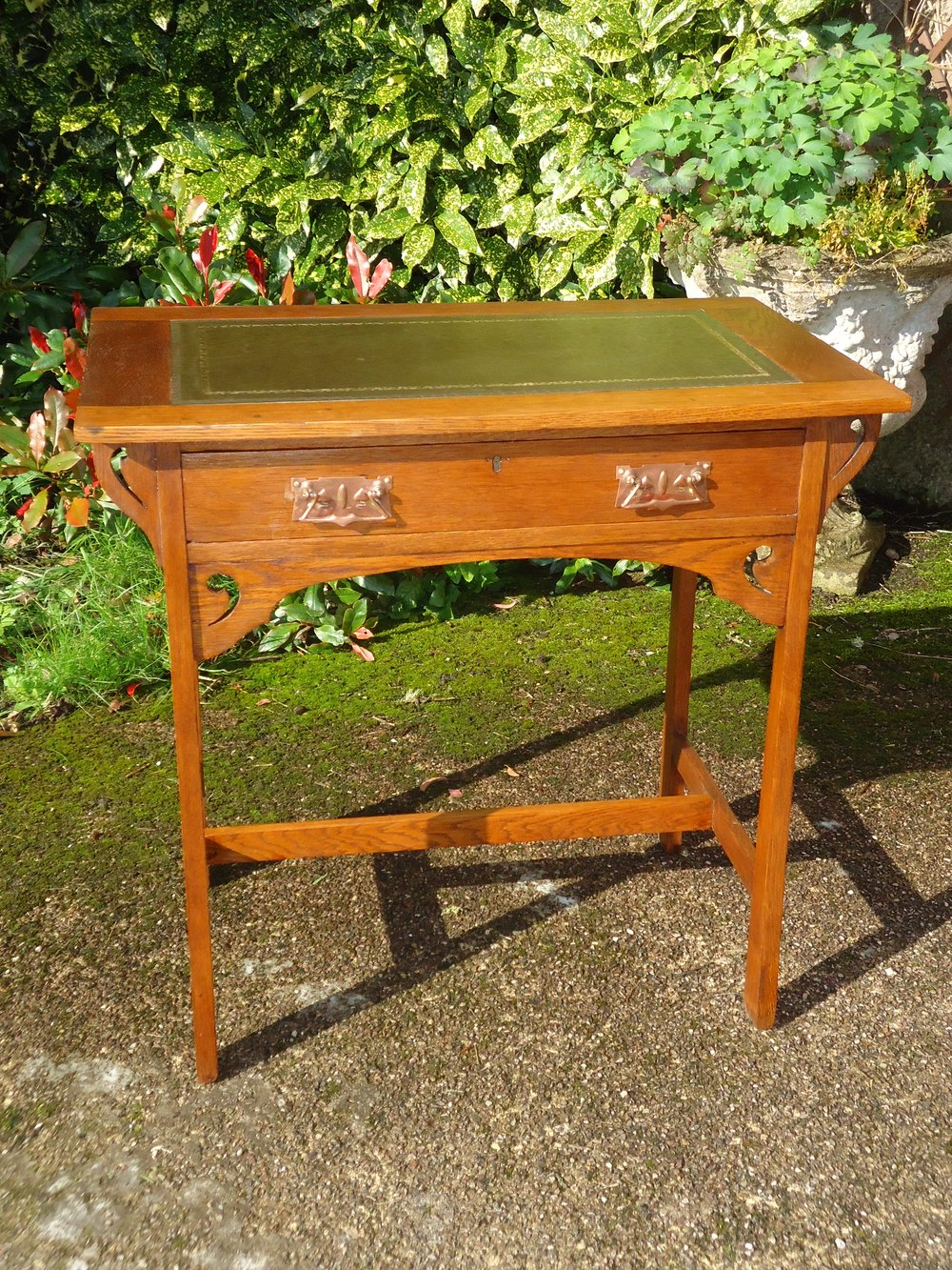 antique oak writing desk An antique oval walnut writing desk this desk features an oval, book-matched walnut top with a molded edge it has six fluted legs, and pierced panels with shelving.